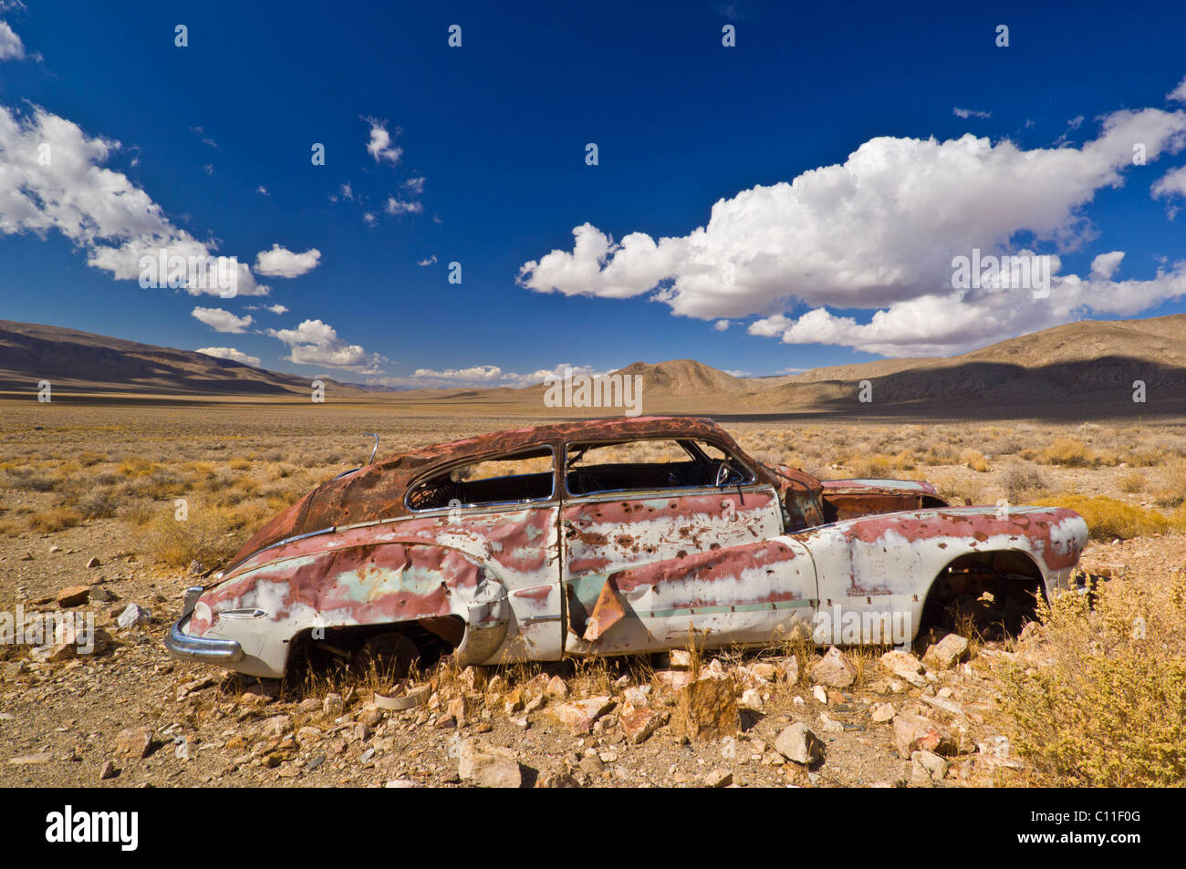 derelict car at Aguereberry camp and homestead Emigrant canyon road Death Valley national Park California USA - Stock Image
