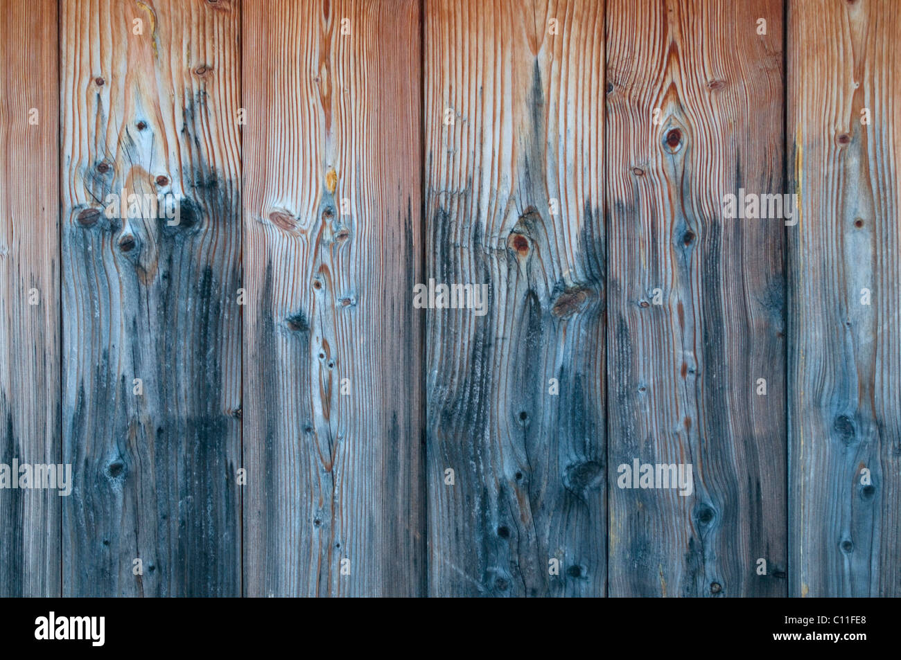 Detailed wooden boards with weathered gray areas, background - Stock Image