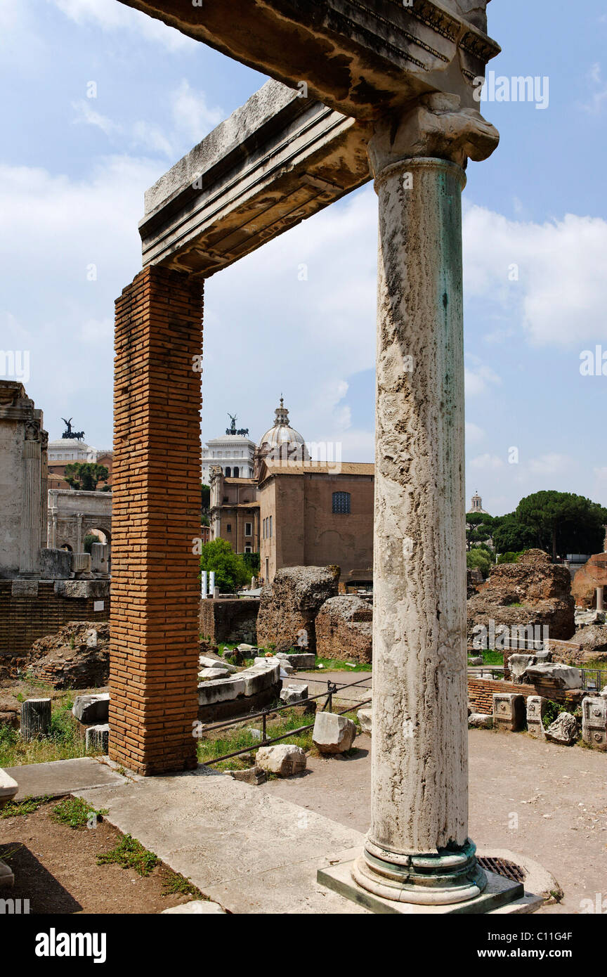Remains of the pillars at the House of the Vestal Virgins, in the rear the Curia, Forum Romanum or Roman Forum, Stock Photo