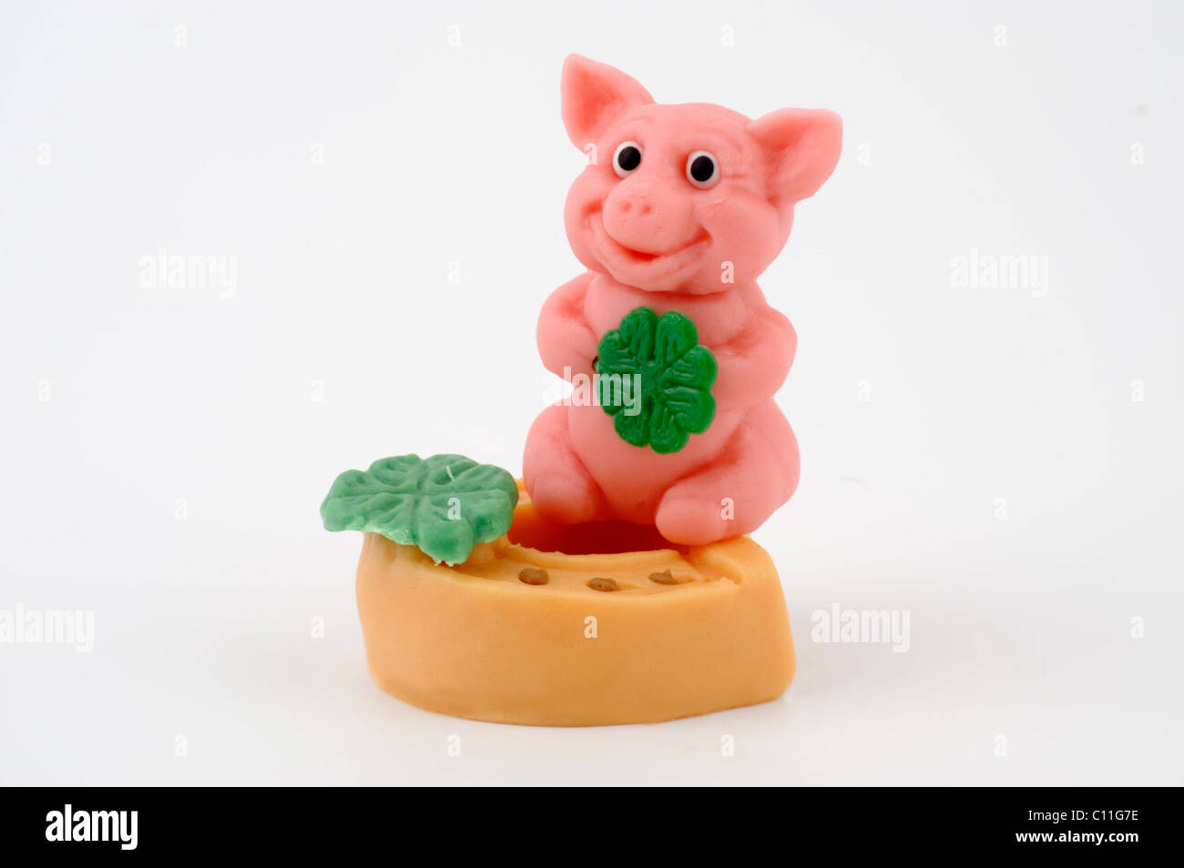 Lucky charm, good luck charm, marzipan, pig, horse shoe, four leaf clover, New Year, New Year's Eve - Stock Image