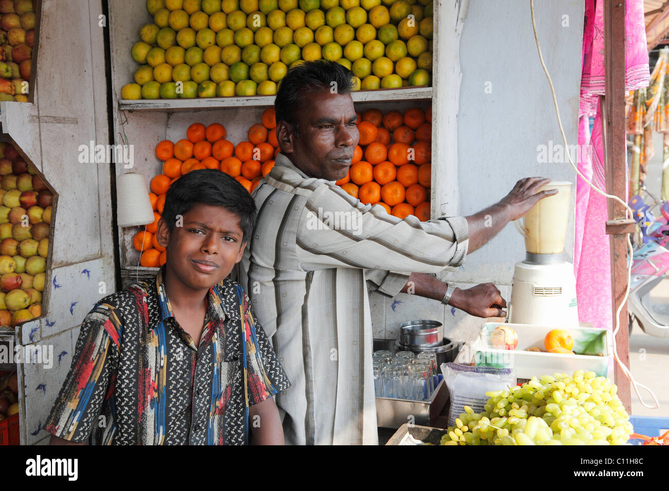 Father and son in a fruit shop with juice mixer, Punjaipuliampatti, Tamil Nadu, Tamilnadu, South India, India, South - Stock Image