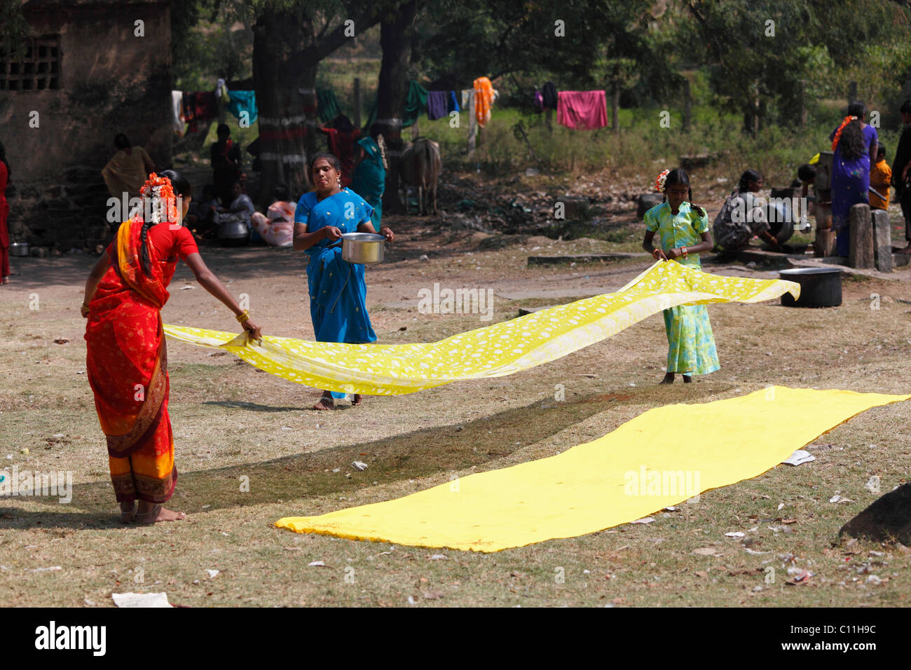 Yellow cloths being spread out, Nanjangud, Karnataka, South India, India, South Asia, Asia - Stock Image