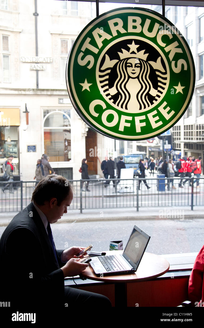 City Worker On Laptop In Starbucks Coffee Shop Monument