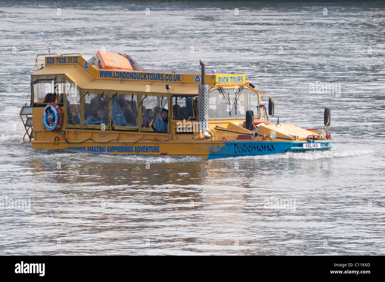 London Duck Tours yellow amphibious vehicle on the River Thames, London, England, UK - Stock Image
