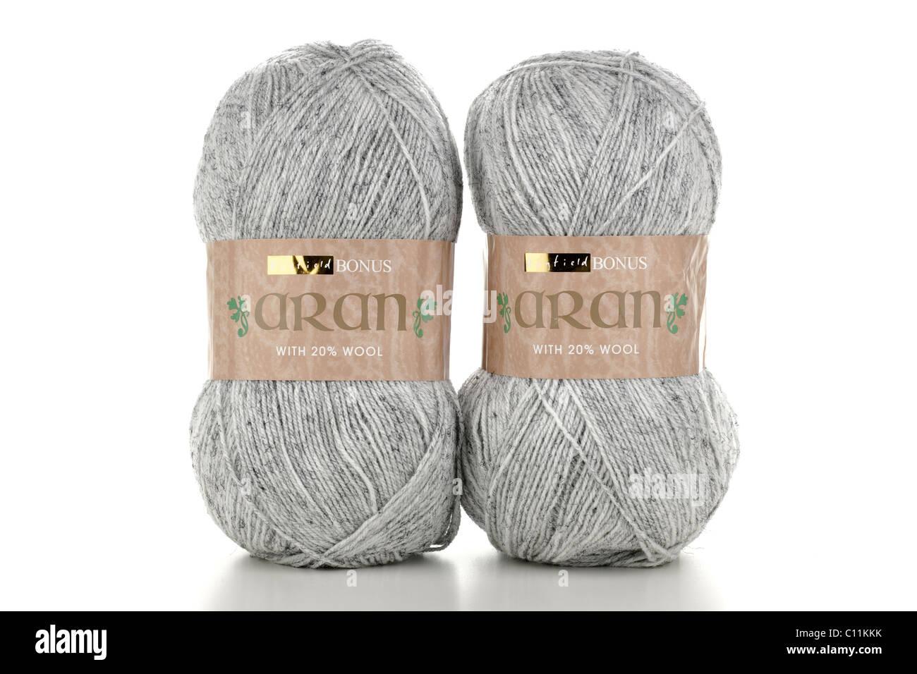 Two 400 gram balls of Hayfield Aran grey white flecked wool - Stock Image