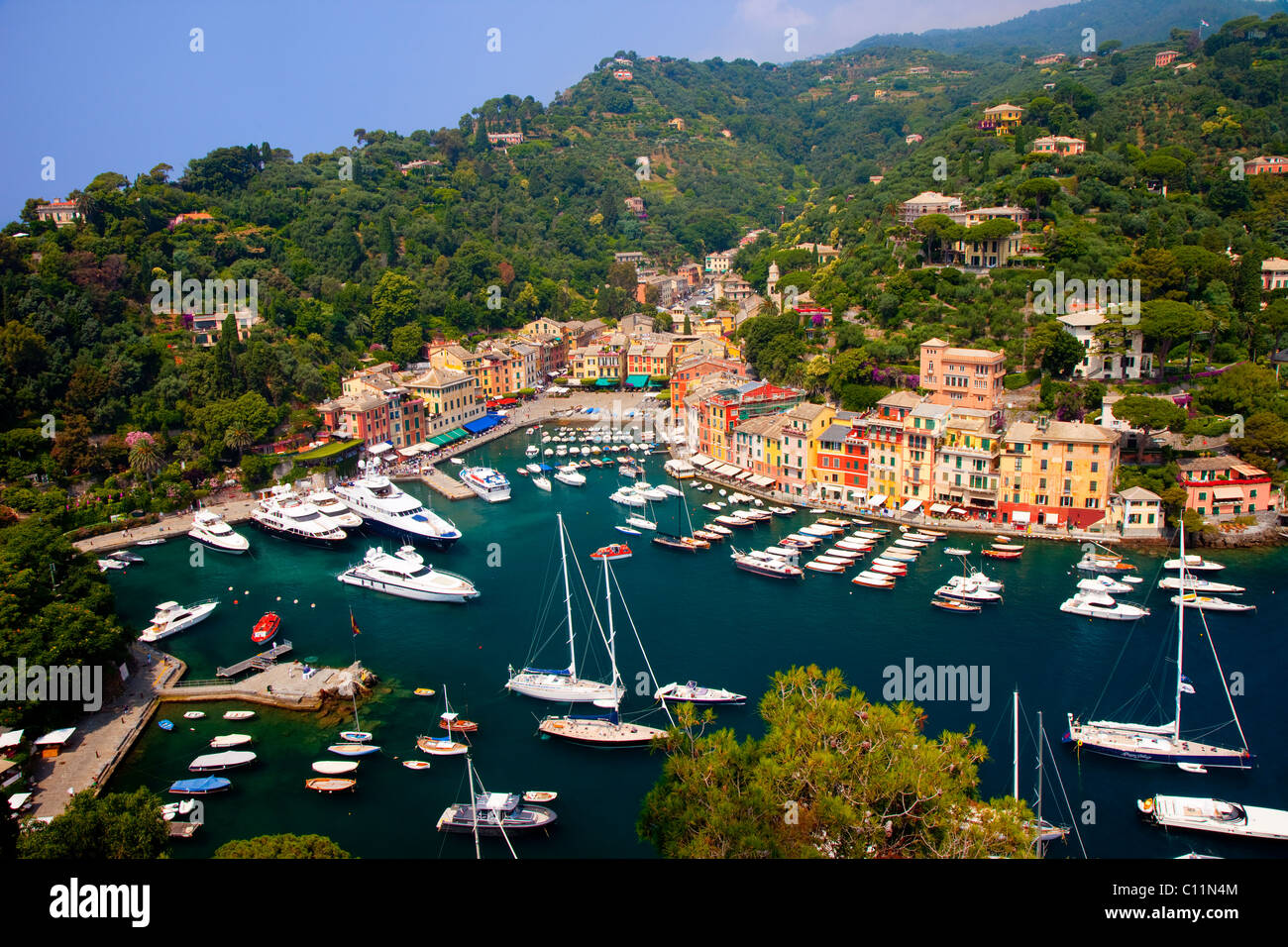 Boats moored in the tiny harbor of Portofino, Liguria Italy - Stock Image