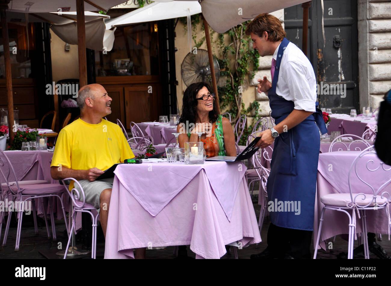 Waiter, guests, Ristorante La Dolce Vita restaurant, Piazza Navona square, Rome, Lazio, Italy, Europe - Stock Image