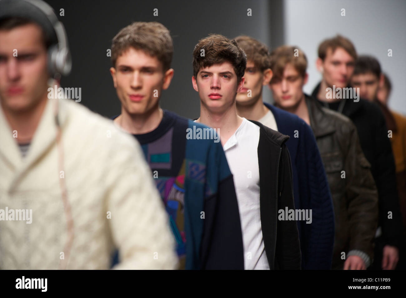 Models do a walk through down the catwalk before the James Long autumn 2011 collection at Somerset House in London - Stock Image