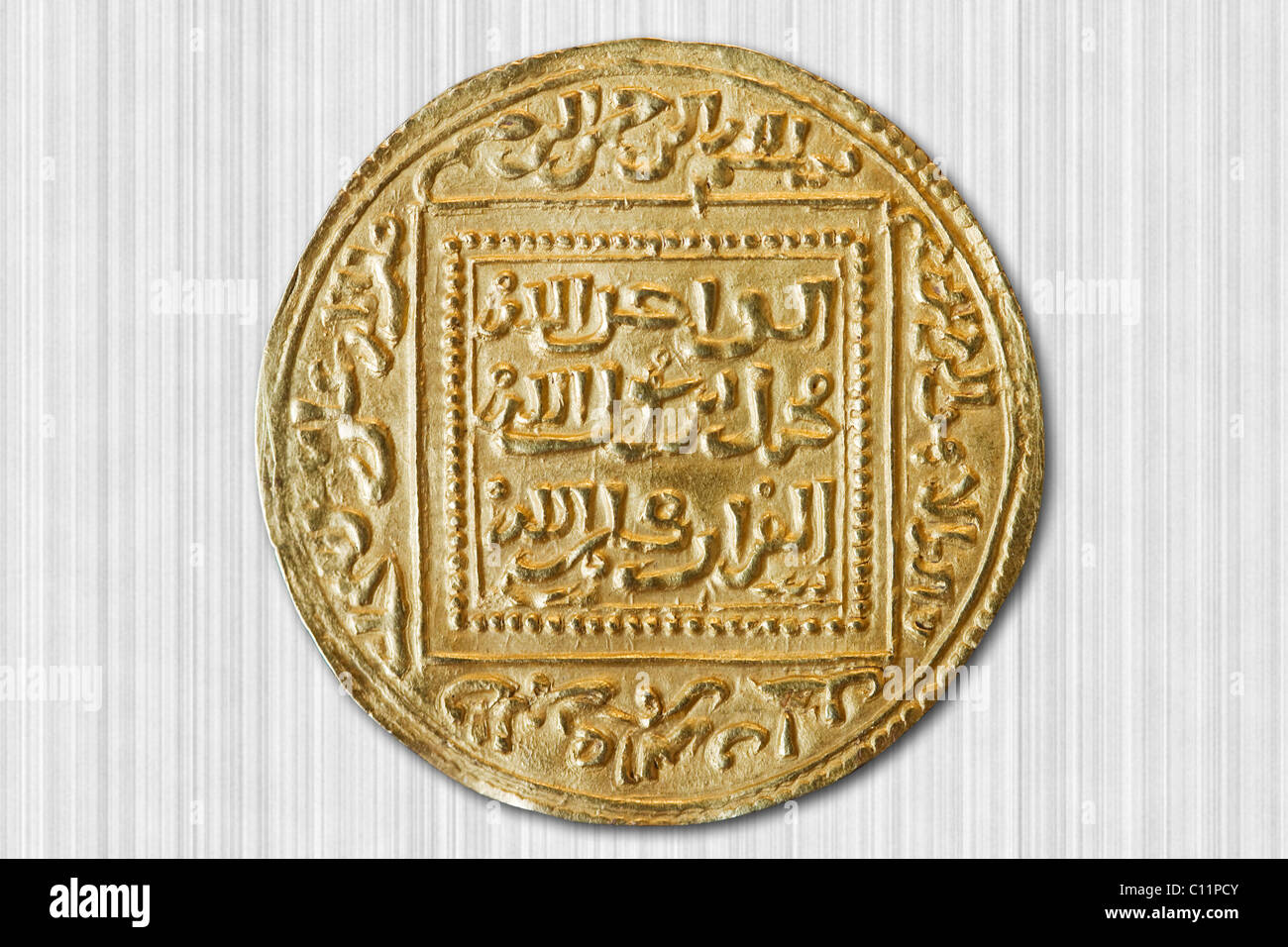 Old dinar coin from the 14th century - Stock Image