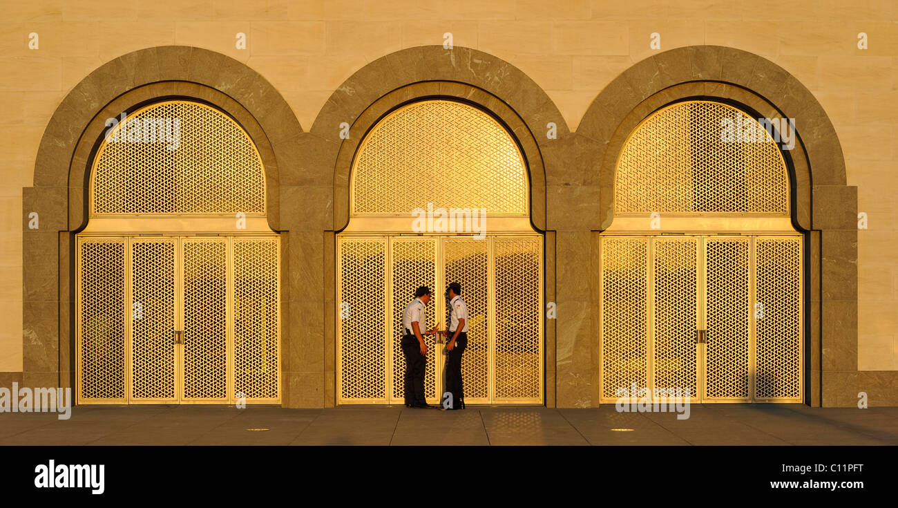 Security staff, gold-plated west entrance, Museum of Islamic Art, designed by I.M. PEI, evening atmosphere, Corniche, Stock Photo
