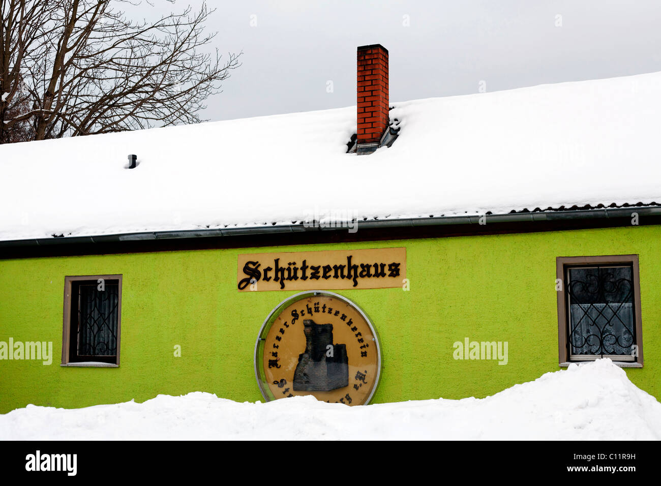 Snow-covered clubhouse, painted in a light green, Stecklenberg, Thale, Northern Harz, Saxony-Anhalt, Germany, Europe - Stock Image