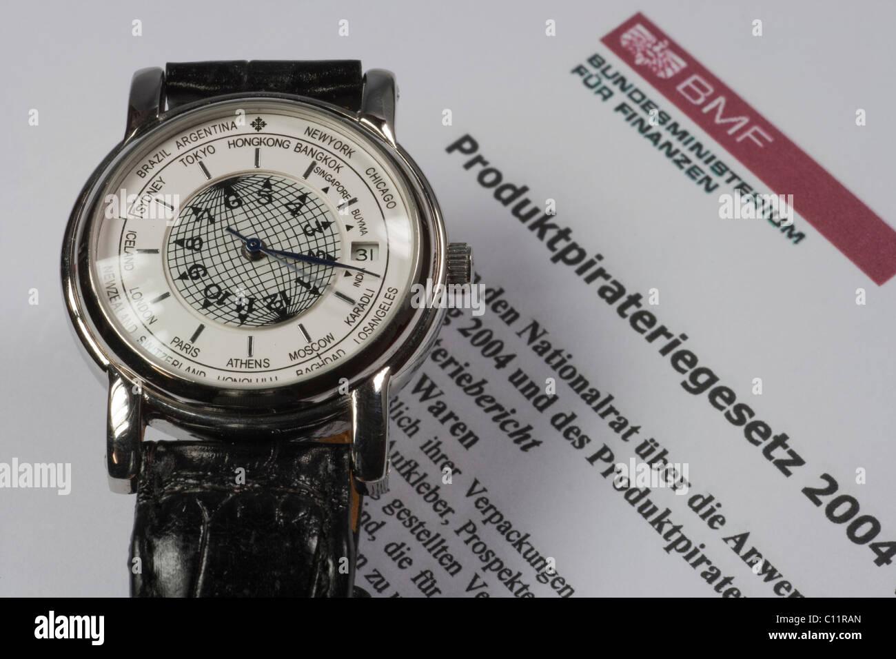 Fake luxury watch, product piracy - Stock Image
