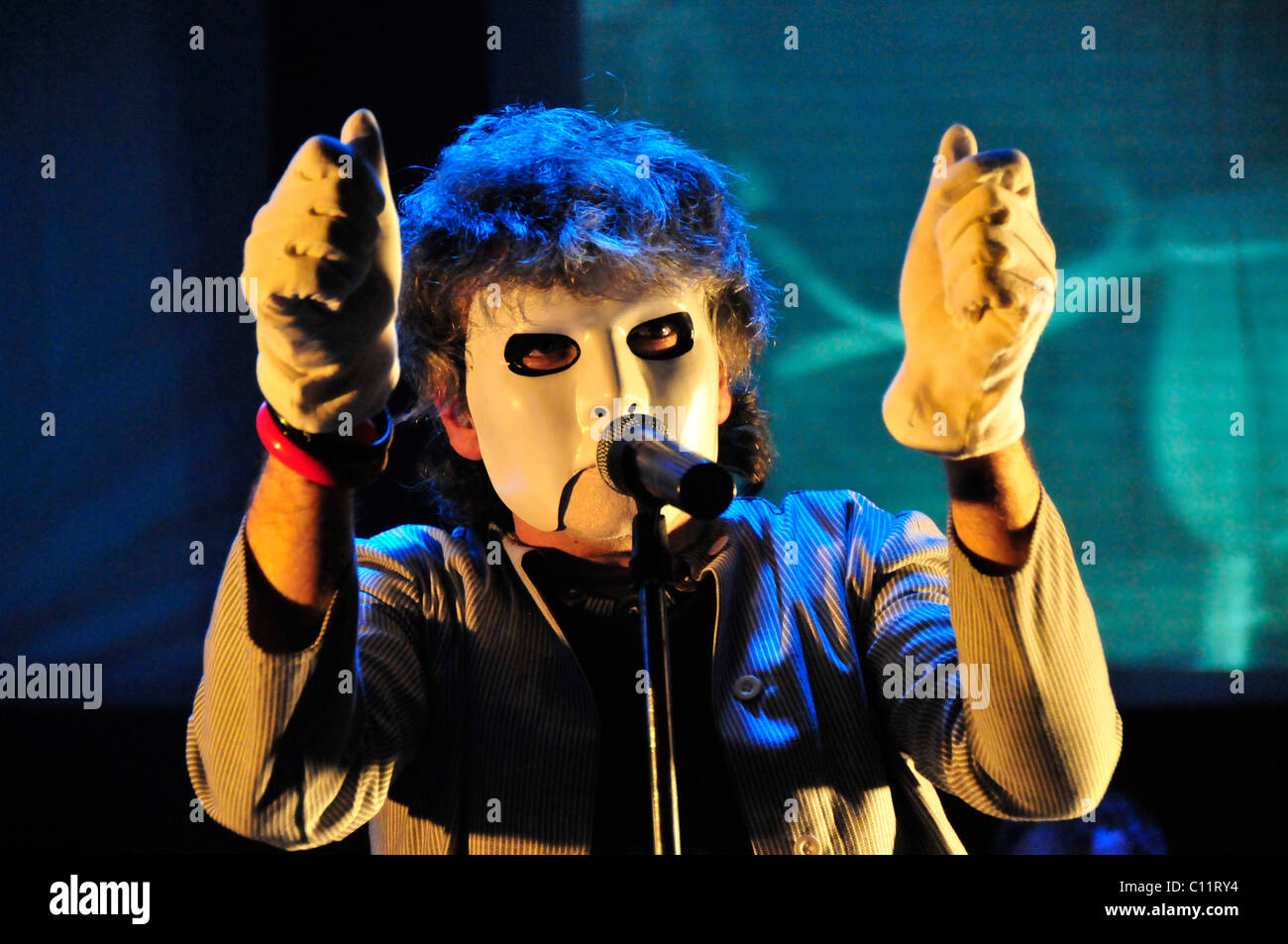 Peter Nicholls, frontman of the British rock band IQ, performing one of his theatrical performances in December - Stock Image