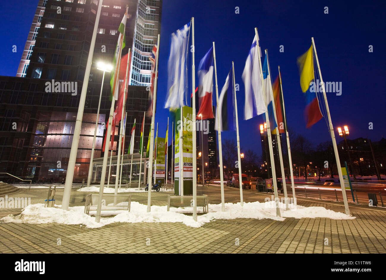 Flags of nations at the main entrance to the Messe Frankfurt Trade Fair, in front of the Messeturm building, Frankfurt, Stock Photo