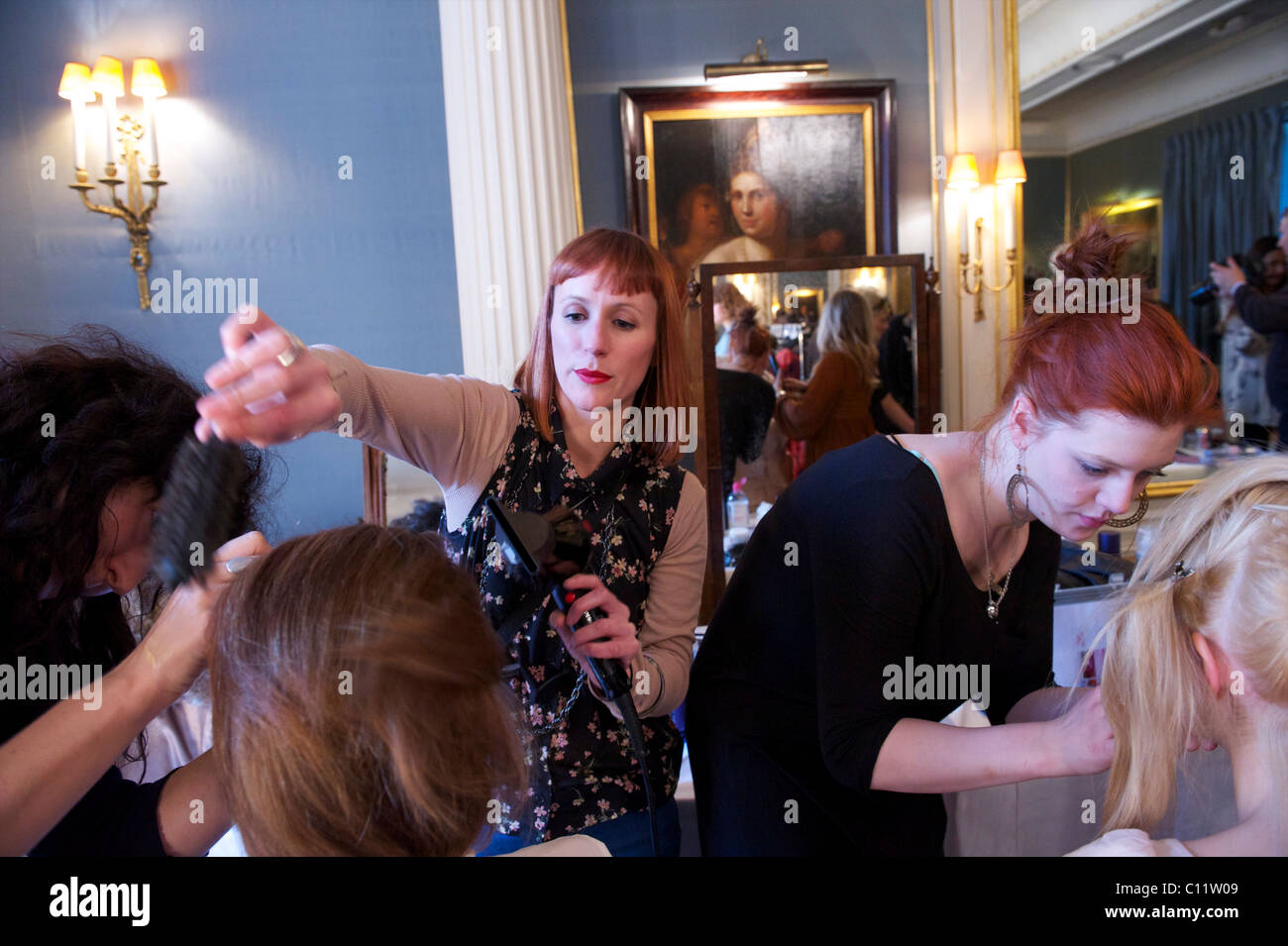 Stylists prepare models backstage before Saloni autumn 2011 collection at the Savile Club in London on 18 February - Stock Image