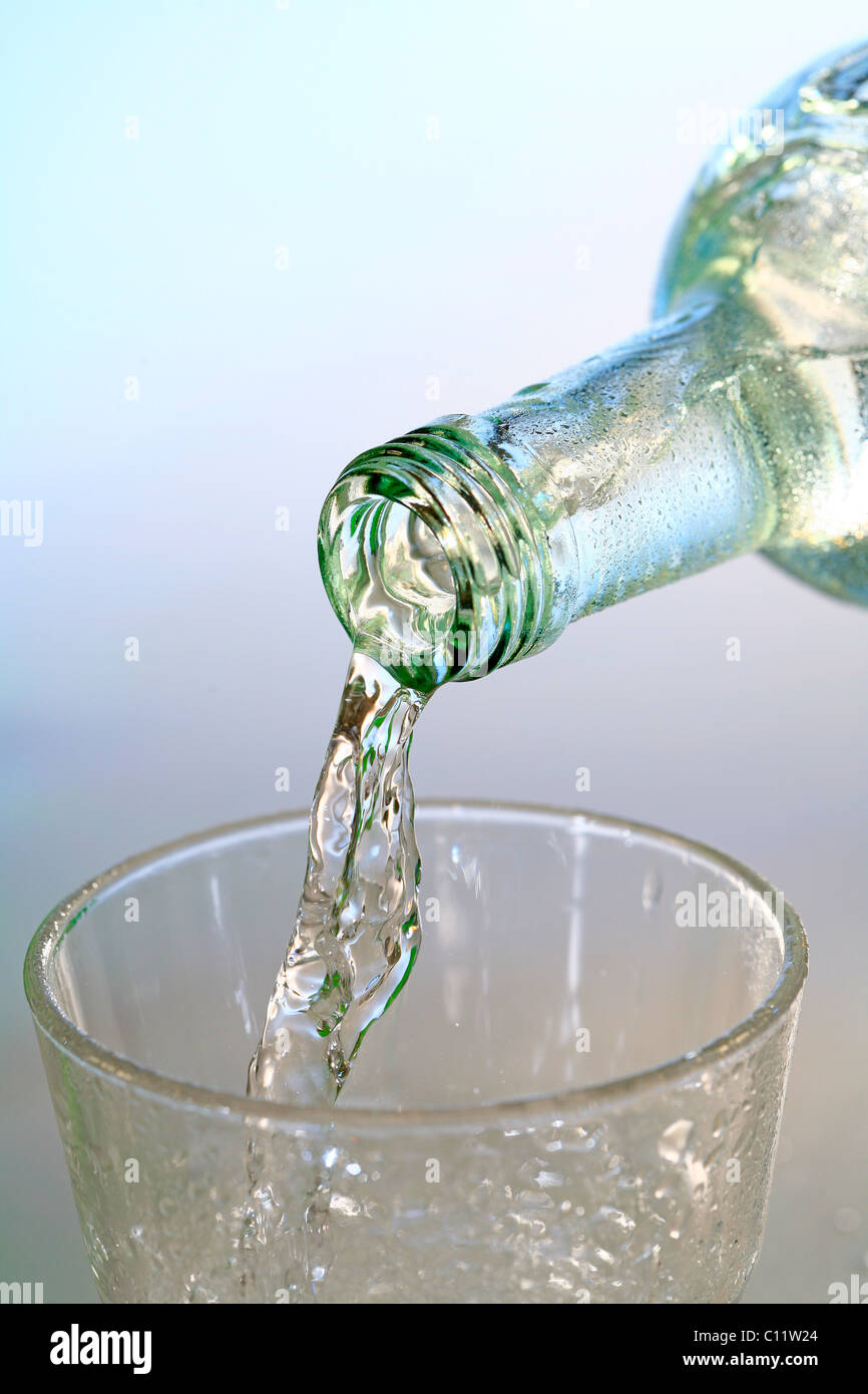 Mineral water bottle and a glass of water, drinking water Stock Photo