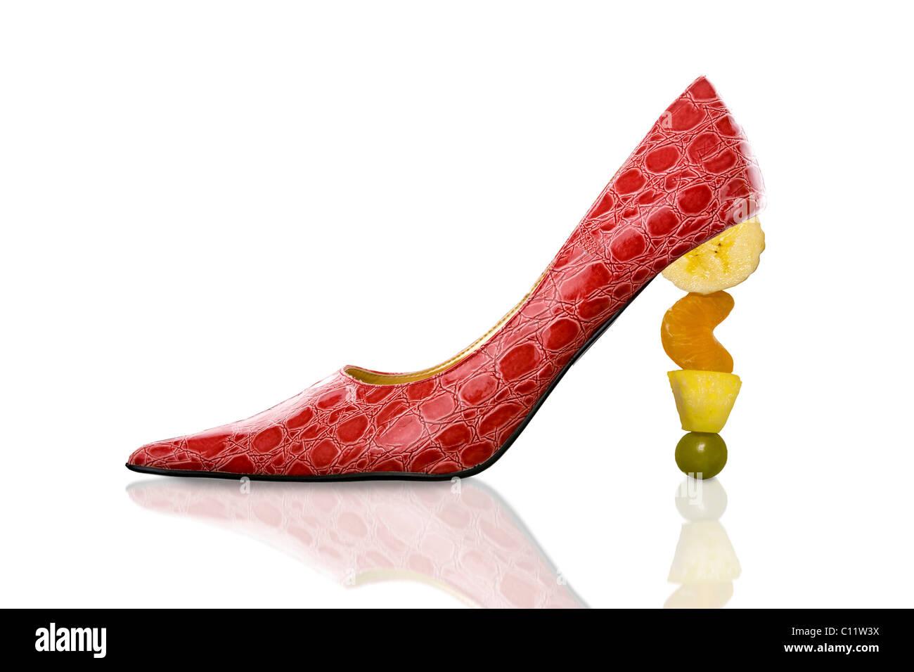 Glamorous high heels with fruit heel - Stock Image