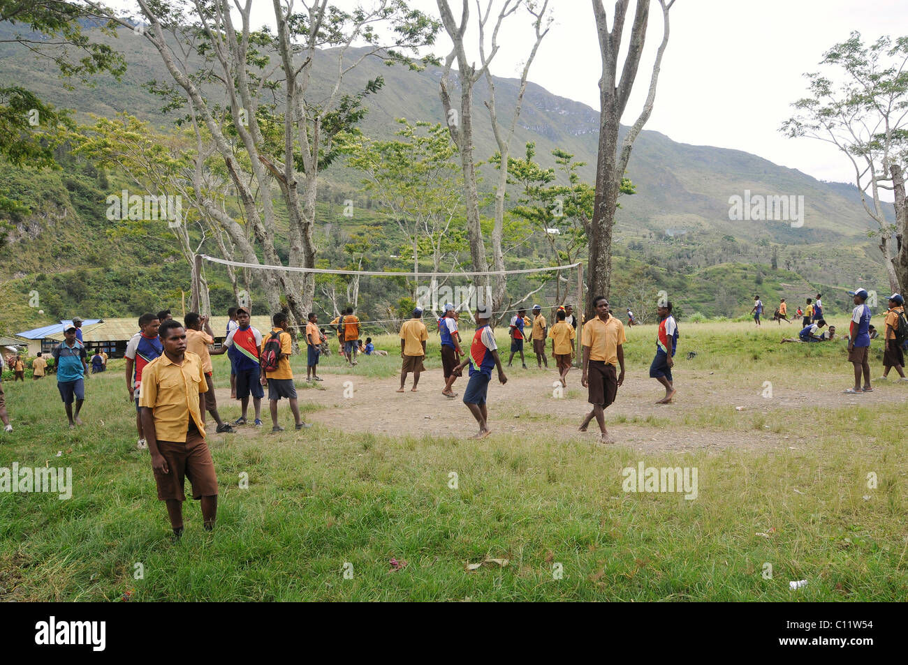 Middle school, students playing volleyball, junior high school, SMP Kurima, Baliem Valley, Irian Jaya, Indonesia, - Stock Image