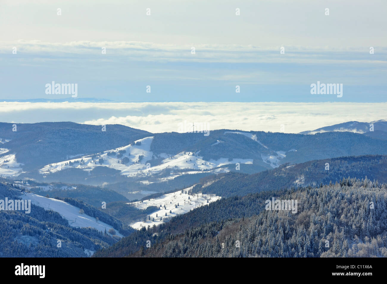 View from Mt. Feldberg on the wintry meadow valley and the hills of the high Black Forest, Landkreis Breisgau-Hochschwarzwald - Stock Image