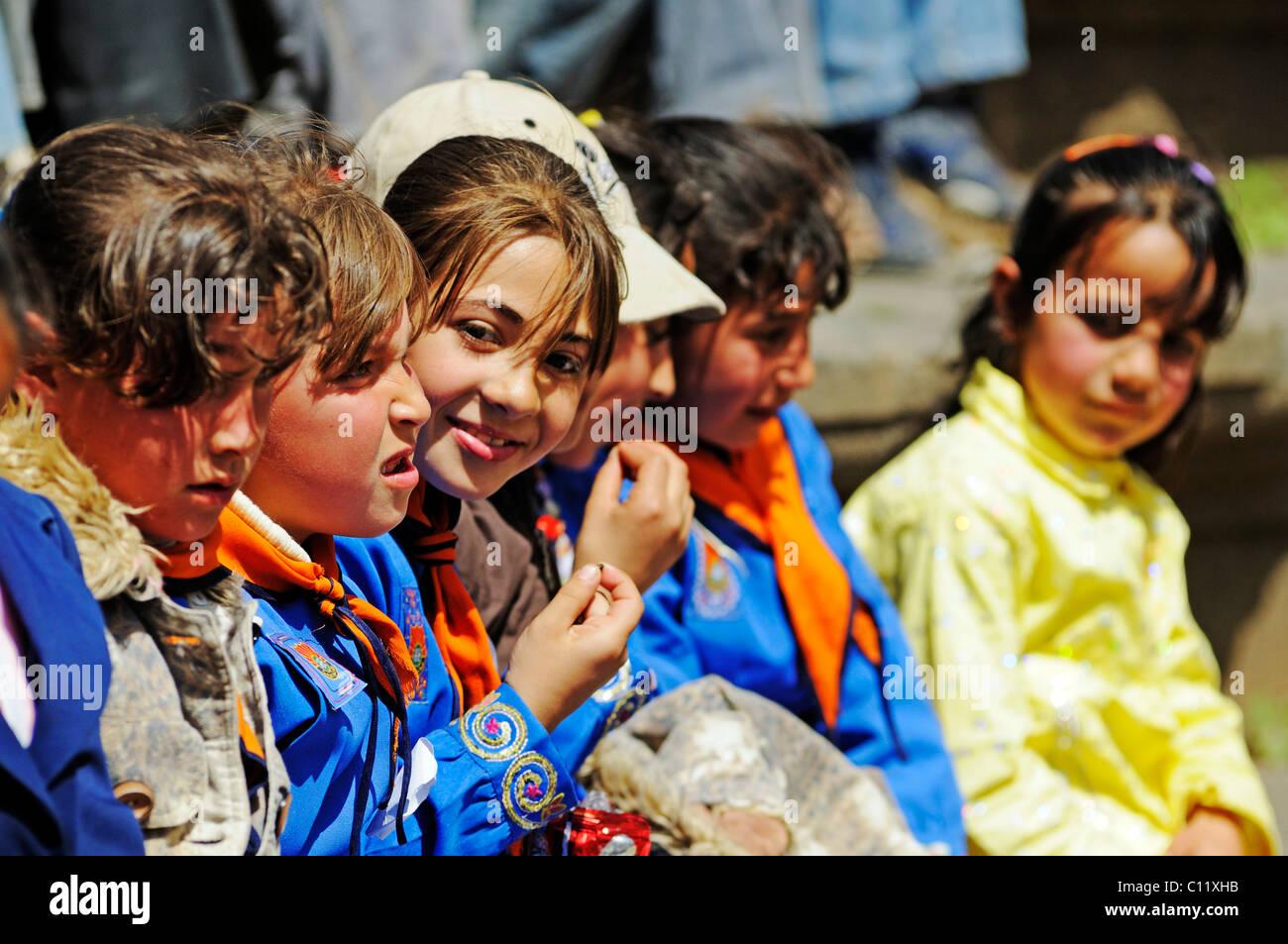Children in school uniforms, Roman theater in Bosra, Syria, Asia - Stock Image