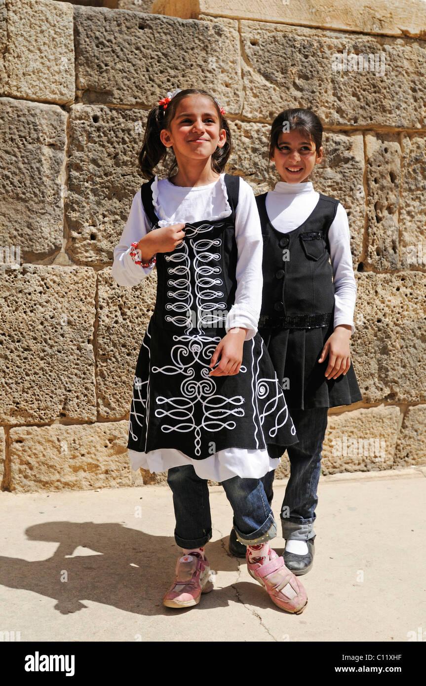 Children, Roman theater in Bosra, Syria, Asia - Stock Image