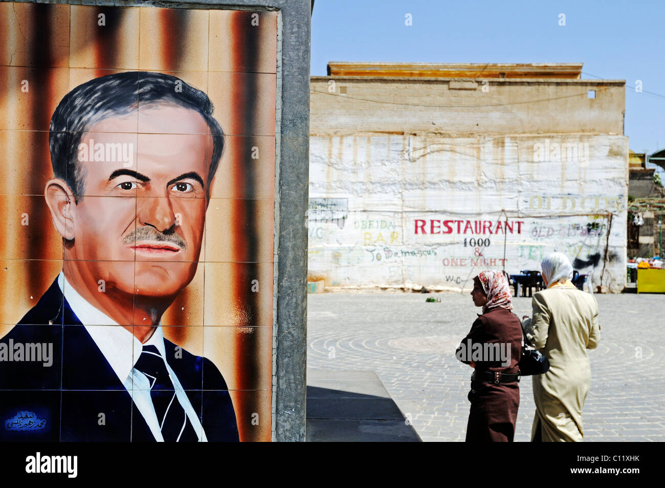 Tiles with a portrait of former President Hafez al Assad, and women with headscarves, Bosra, Syria, Asia - Stock Image