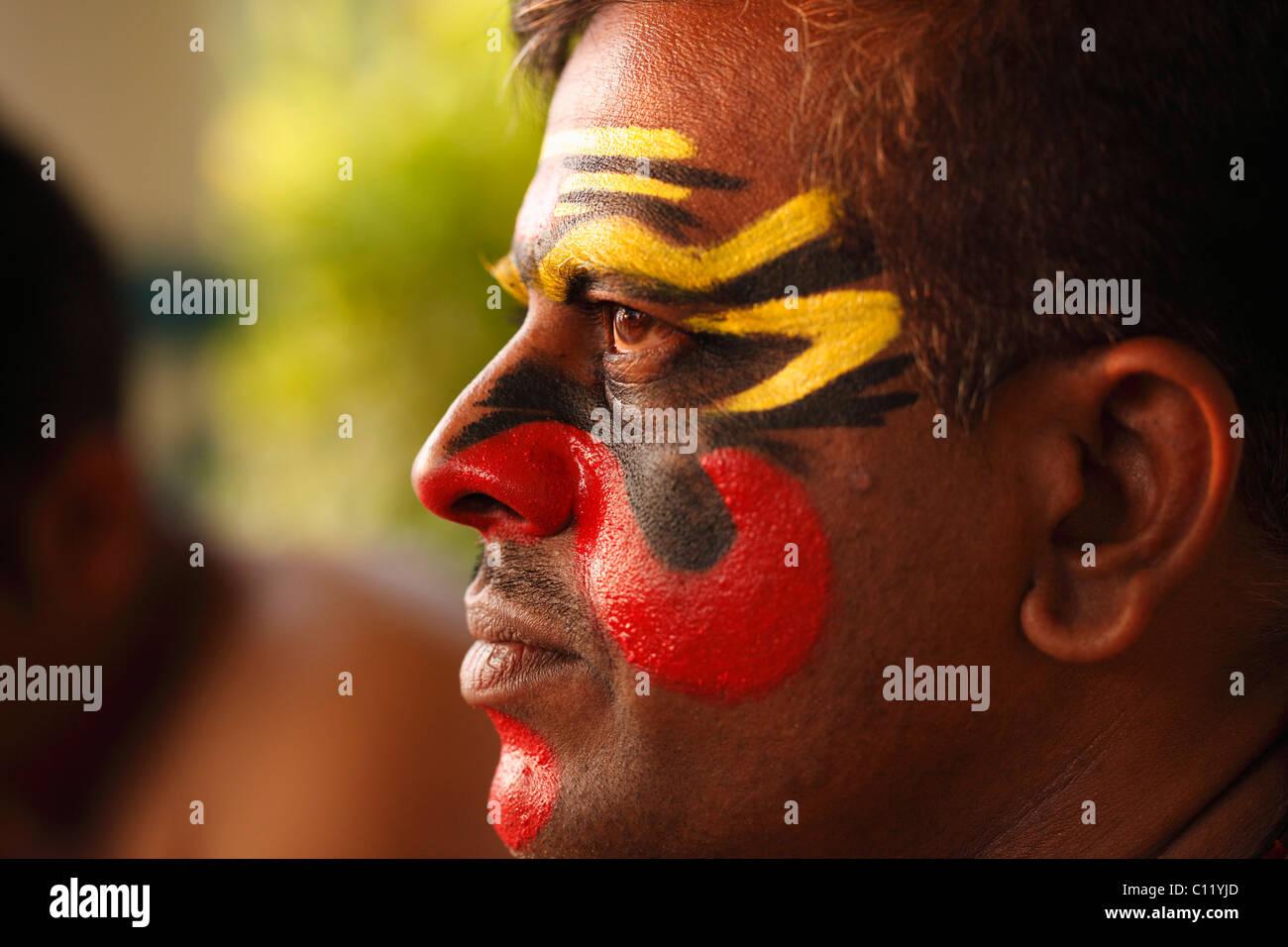 Kathakali dancer with half-finished make up, Chuvanna Thaadi mask, Kerala, southern India, Asia - Stock Image