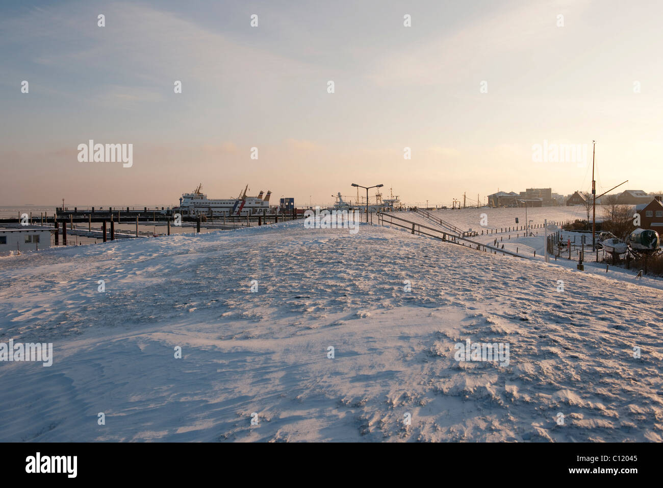Even in deepest winter the ferry service between the mainland and the North Sea island of Foehr is maintained, here - Stock Image