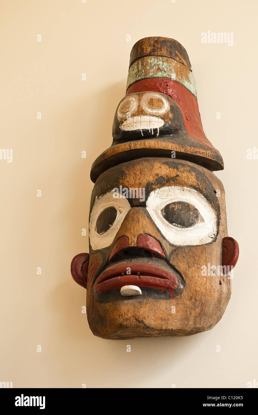 Alaska. Tlingit ceremonial mask exhibit in the Wrangell Museum, Wrangell, Southeast Alaska. - Stock Image