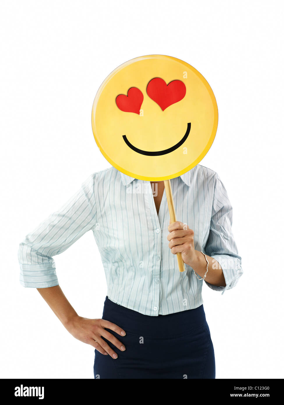 adult business woman holding emoticon with red hearts on white background. Vertical shape, front view, waist up Stock Photo