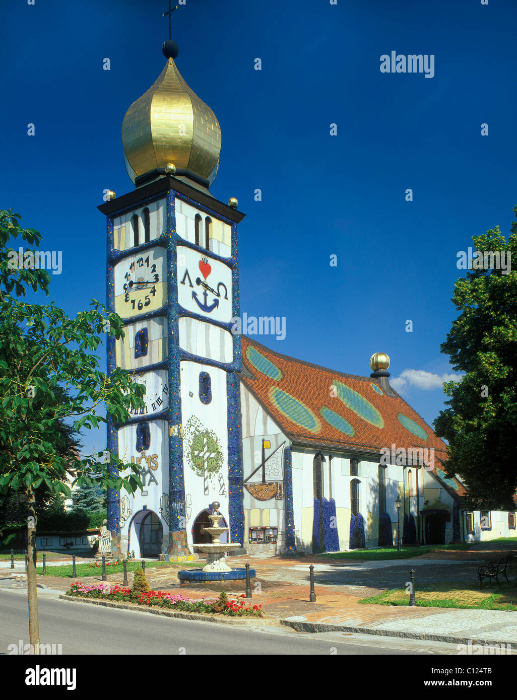 Parish church Saint Barbara, 1987-1988, by Friedensreich Hundertwasser, Baernbach, Styria, Austria, Europe - Stock Image