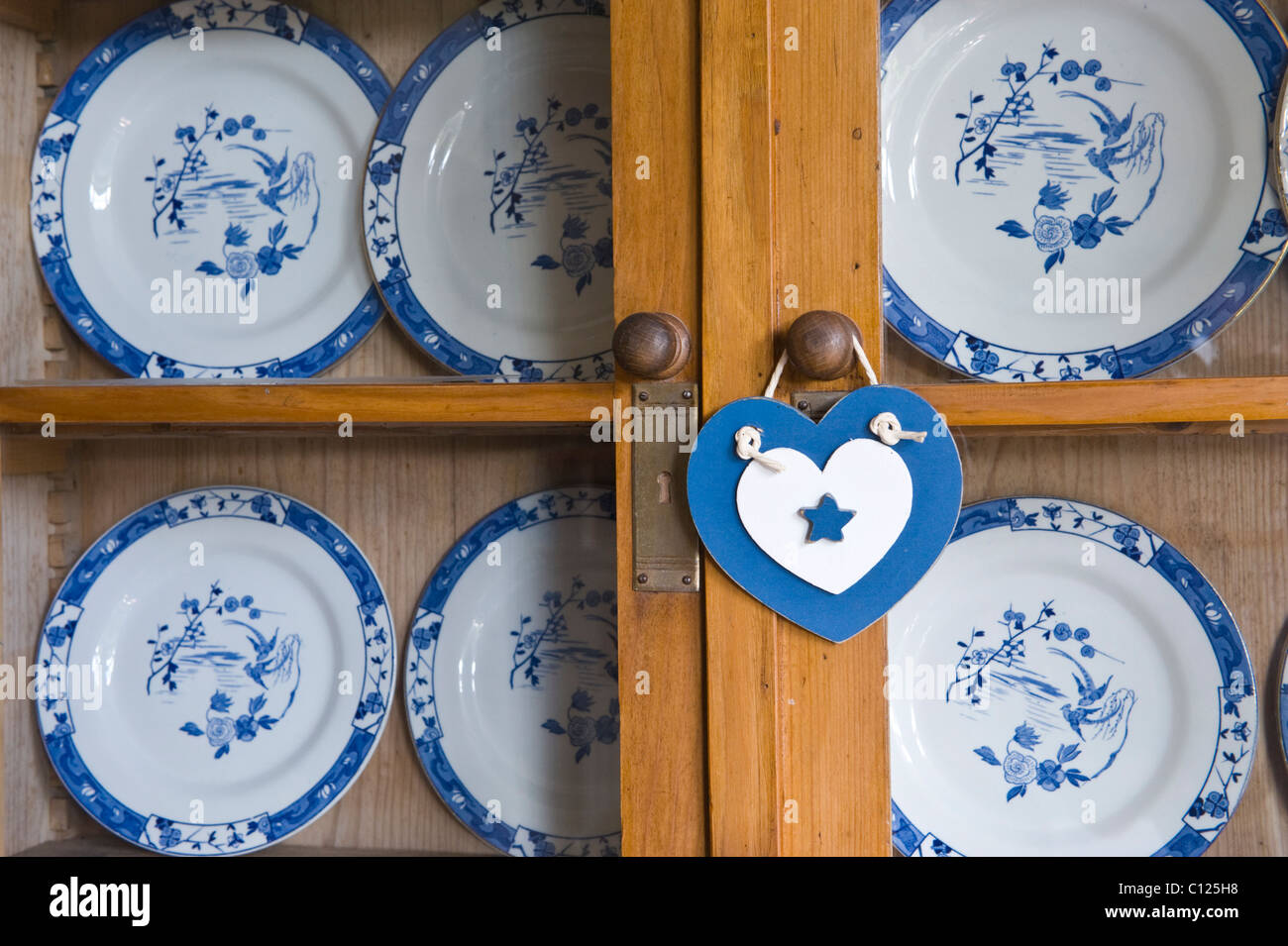 China cabinet with blue and white plates in the lounge of a house in UK - Stock Image