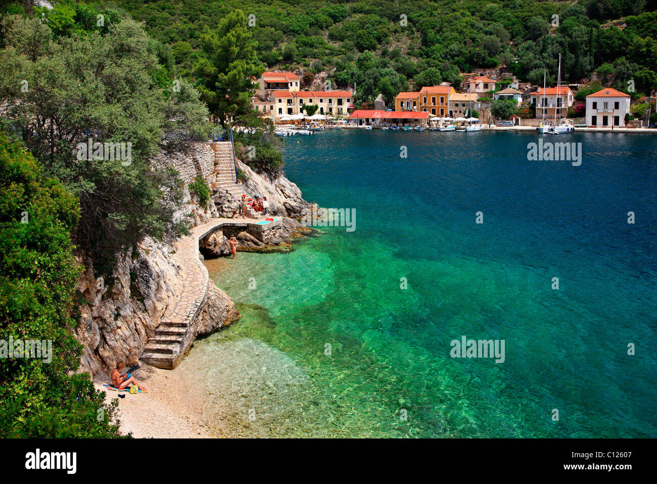 Tiny little beach next to Kioni village,  the most beautiful of Ithaca island, Ulisses' s homeland. Ionian sea, - Stock Image