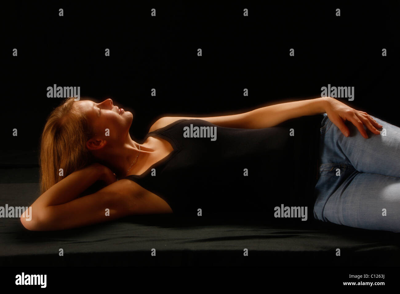 Young woman lying - Stock Image