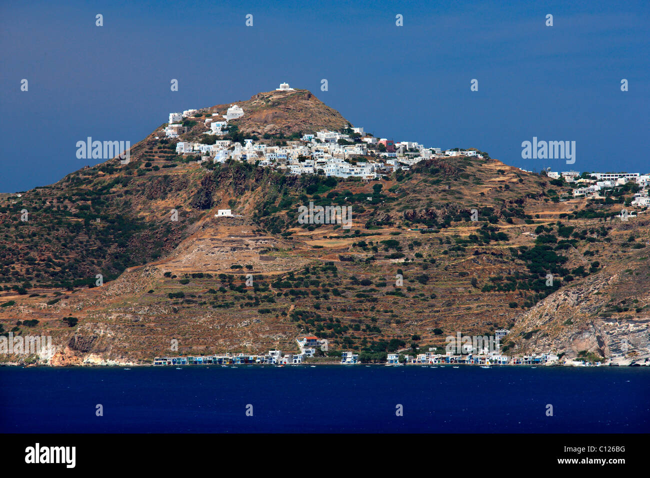 Greece, Milos island.  View of Plaka, Trypiti and Klima villages from Emboreios, on the opposite side of Milos Gulf - Stock Image