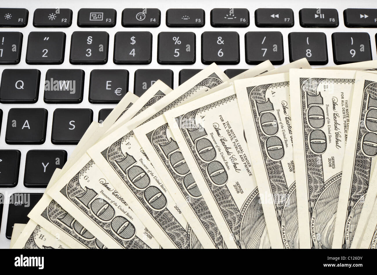 Several 100 Dollar Bills On A Keyboard Euro Symbol Stock Photo