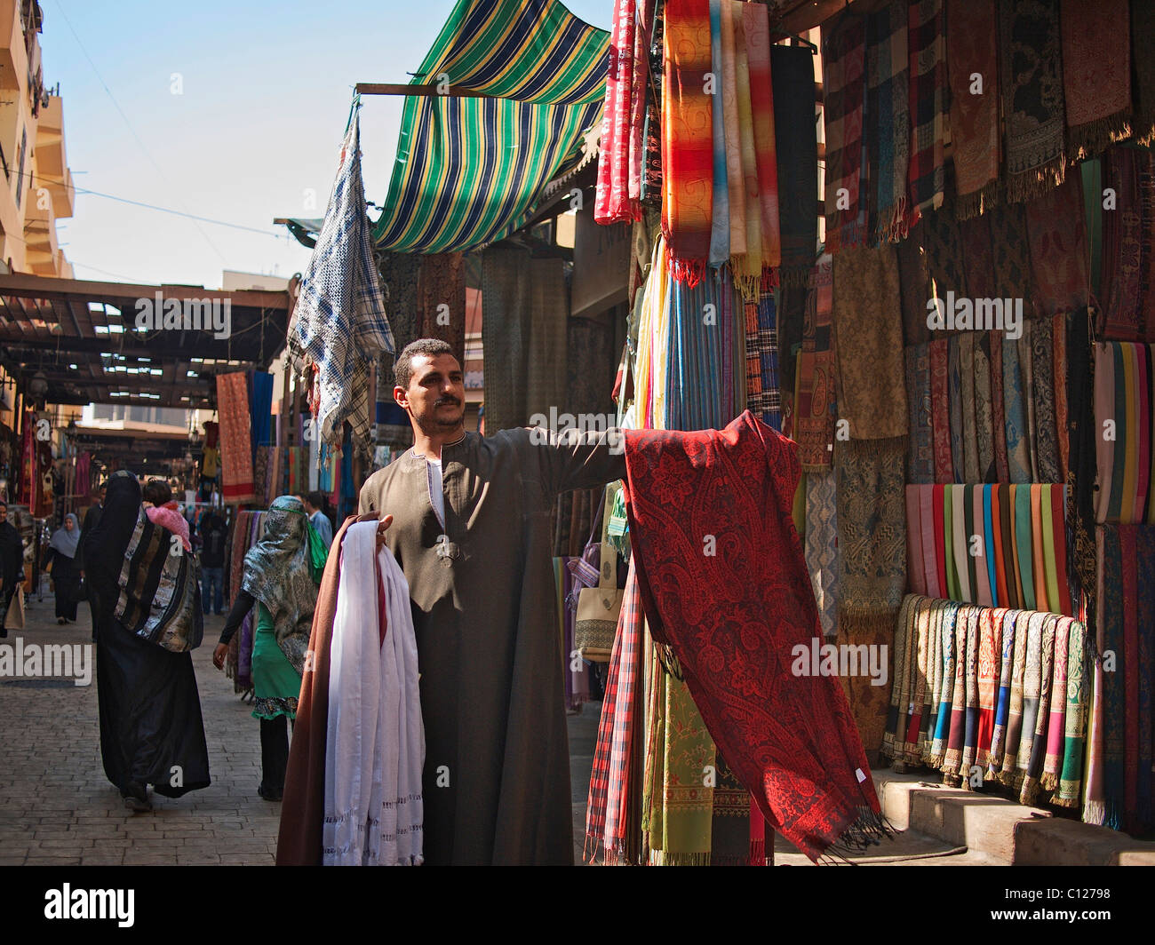 Cloth merchant in the souk of Luxor, Egypt, Africa - Stock Image