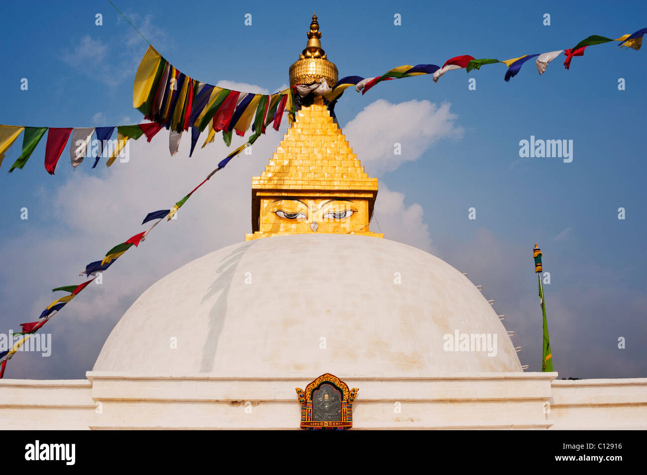 Traditional Nepali style stupa with prayer flags in a Bhutanese convent in Punakha, Bhutan - Stock Image
