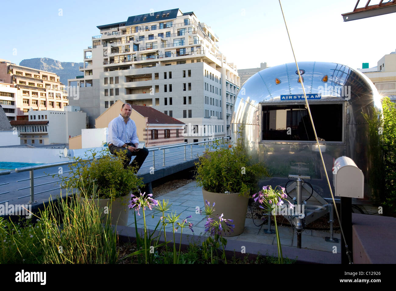 Traveller Jaime Gallo luxury camping on the roof of the Grand Daddy Hotel, Cape Town, Western Cape, South Africa, - Stock Image