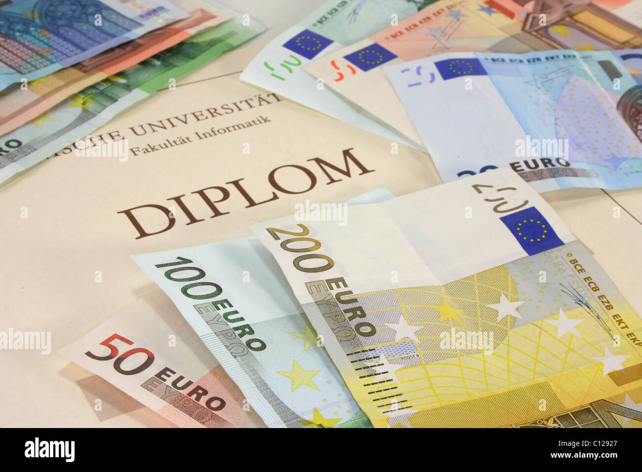 purchased diploma - diploma certificate with many euro notes - Stock Image