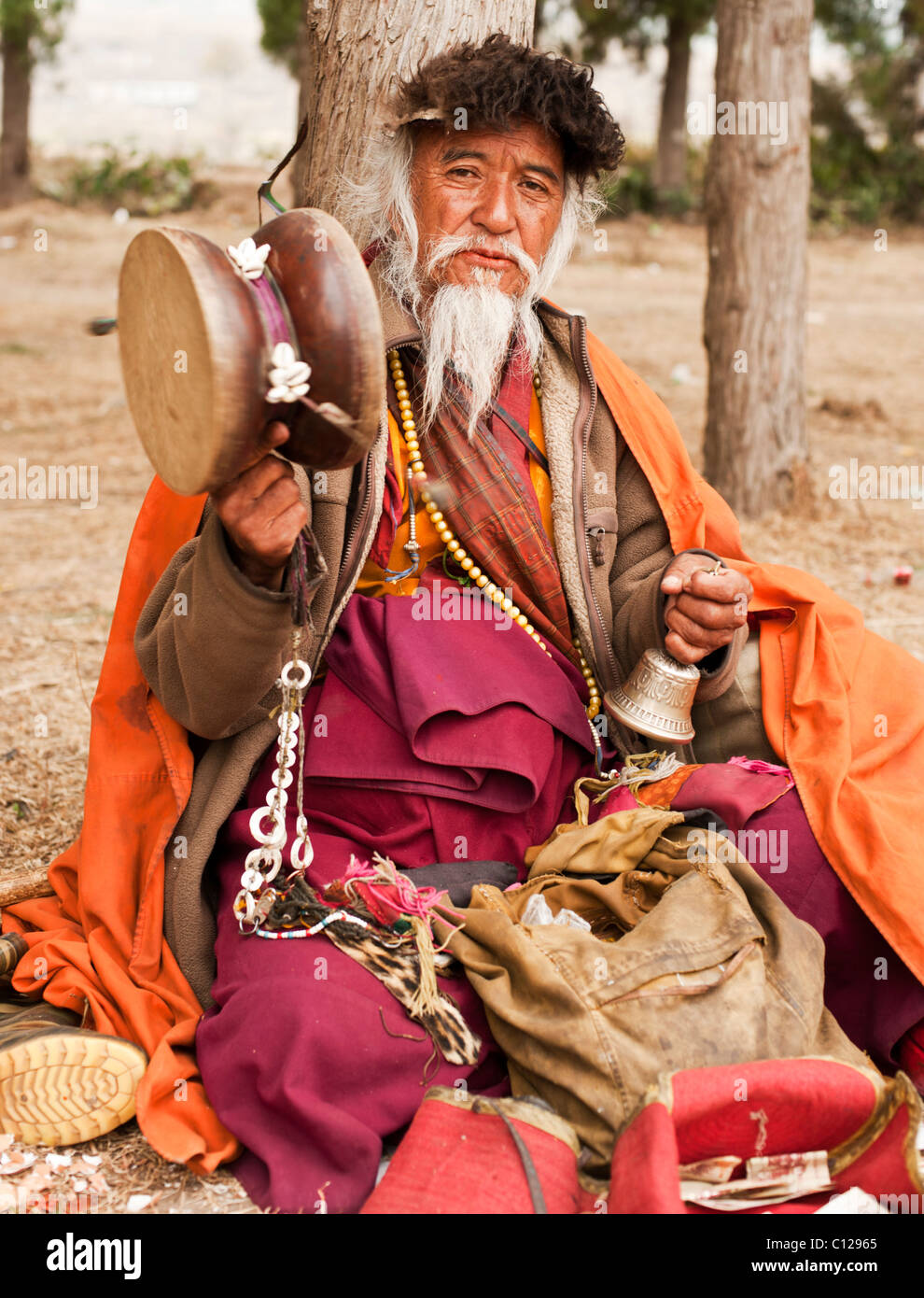 Bhutanese healer or medicine man selling his treatments at a religious festival in Punakha, Bhutan - Stock Image
