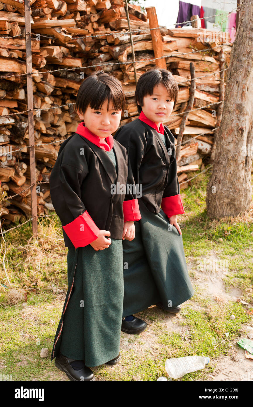 Two young Bhutanese schoolgirls dressed for the first day of school in rural Bhutan - Stock Image