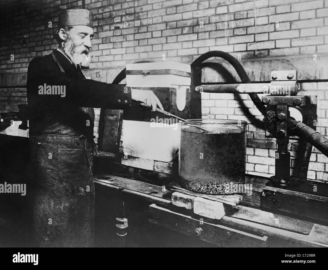 French chemist Henri Moissan (1852 - 1907) - winner of the Nobel Prize in Chemistry in 1906 - attempting to make - Stock Image