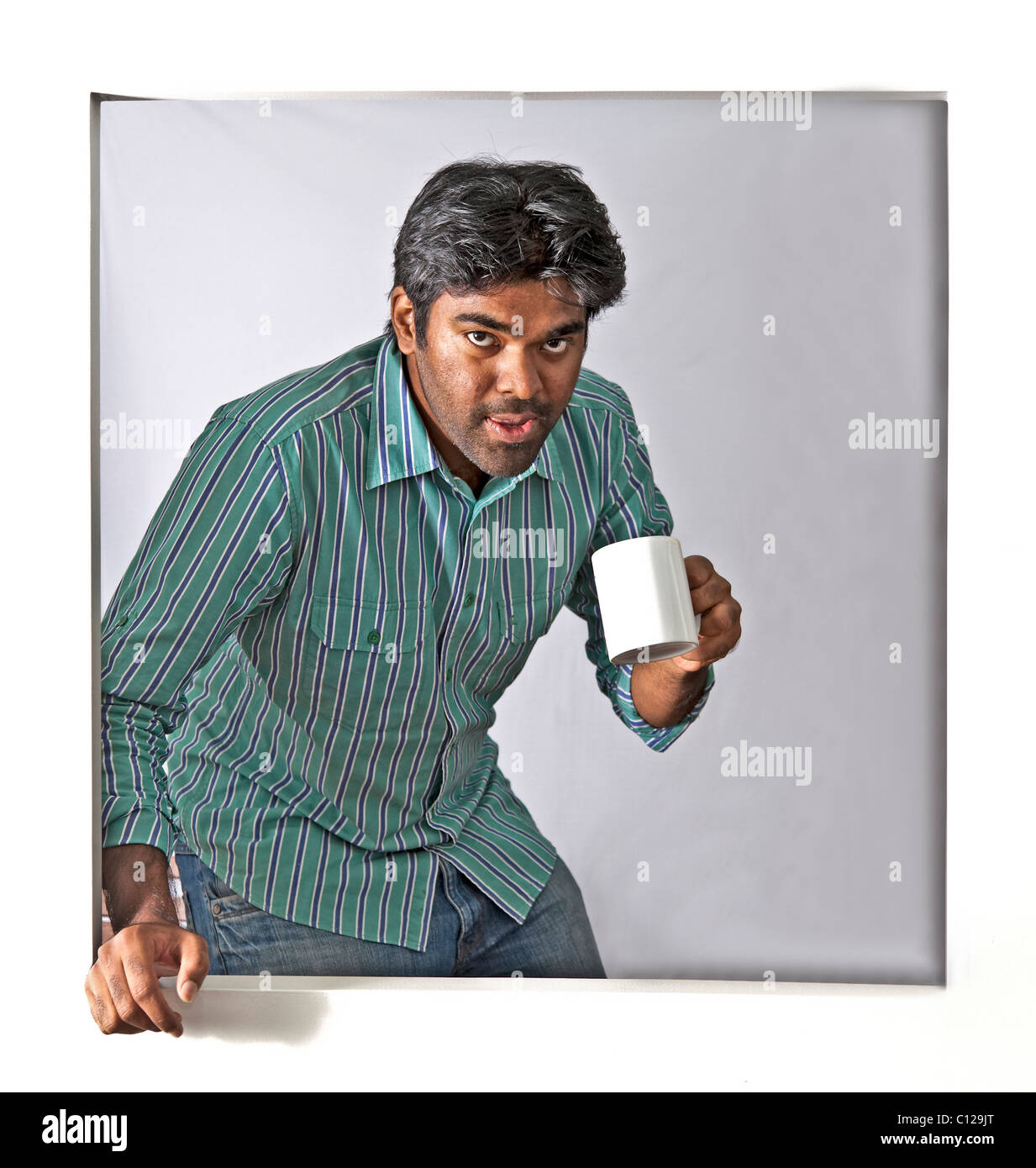 young man having a coffee and a well earned break - Stock Image