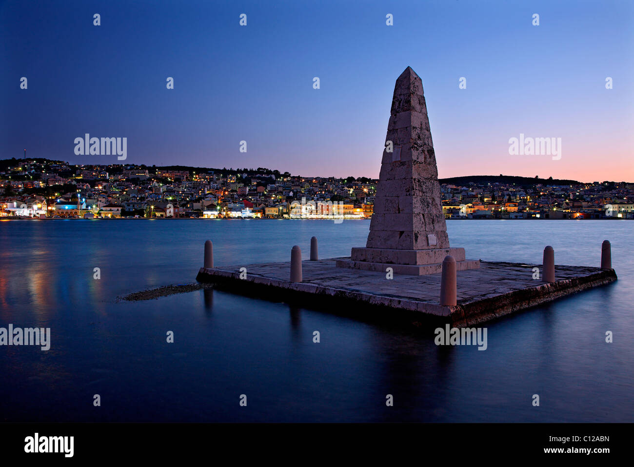 Argostoli town, capital of Kefalonia island and the so-called 'British obelisk' in front. - Stock Image