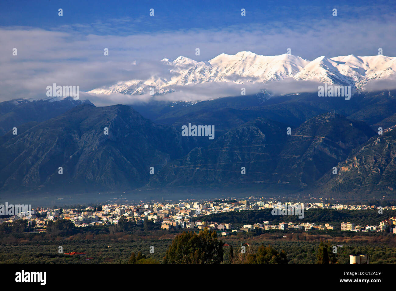 The modern town of Sparta, in the 'shadow' of imposing Taygetos mountain, Lakonia, Greece. - Stock Image