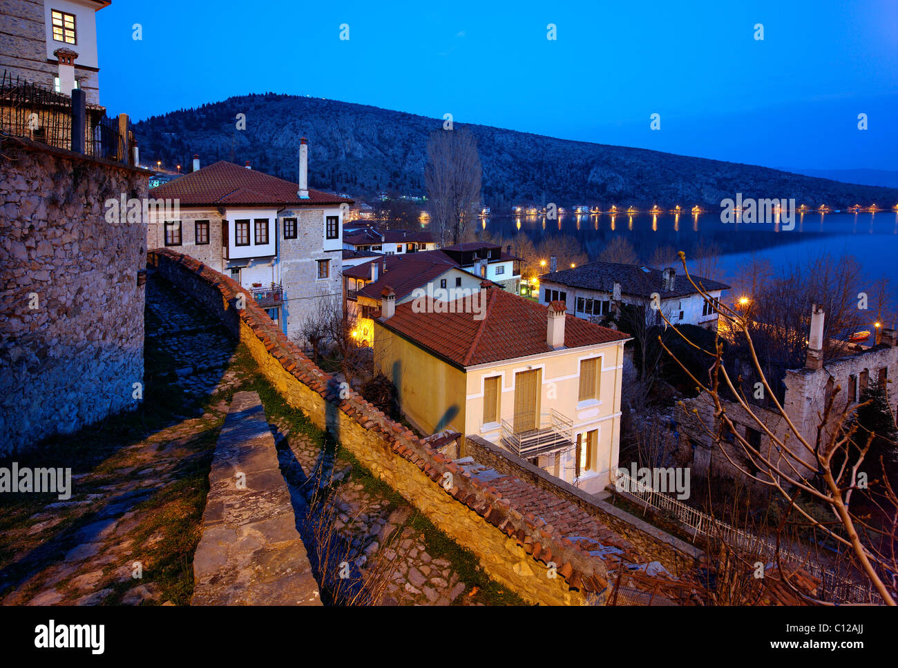 Night falling in picturesque Doltso neighborhood, right beside lake Orestias (or 'Orestiada'), Kastoria - Stock Image