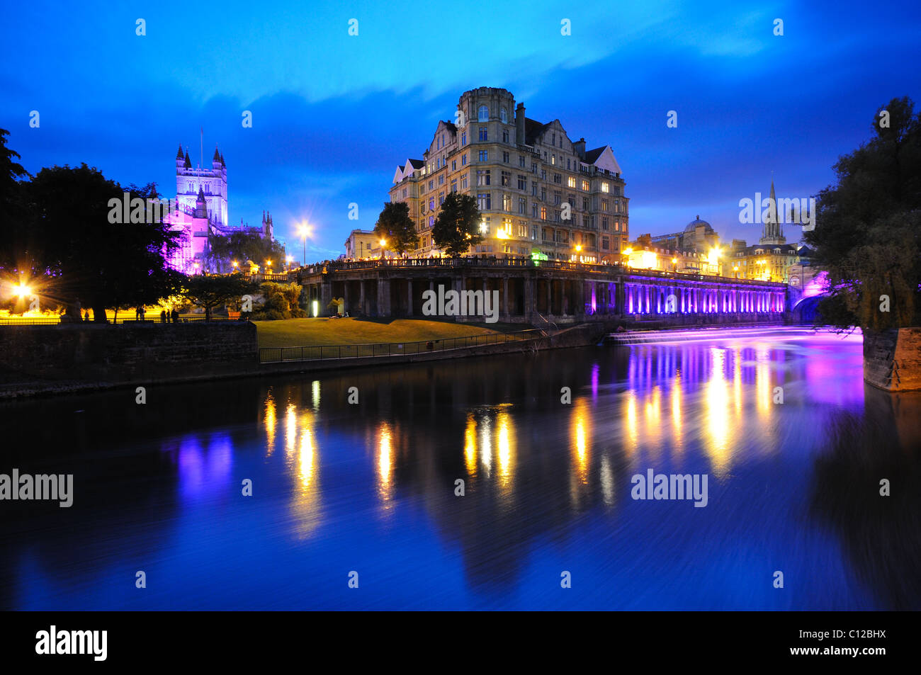 Bath's Abbey, Empire Hotel & Weir lit architecturally at twilight. - Stock Image