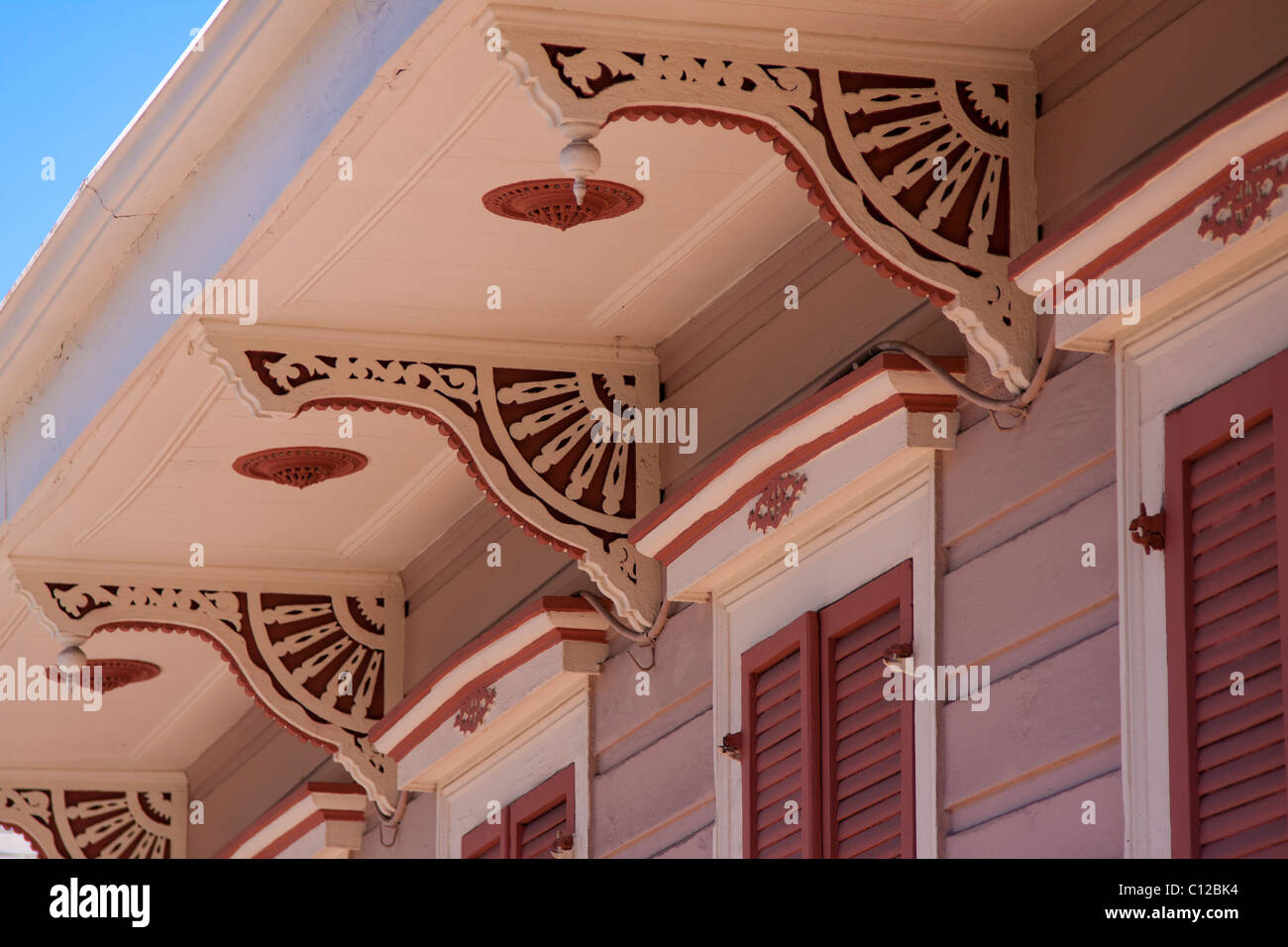 Closeup of decorative corbels on a Creole townhouse in the French Quarter of New Orleans, Louisiana - Stock Image