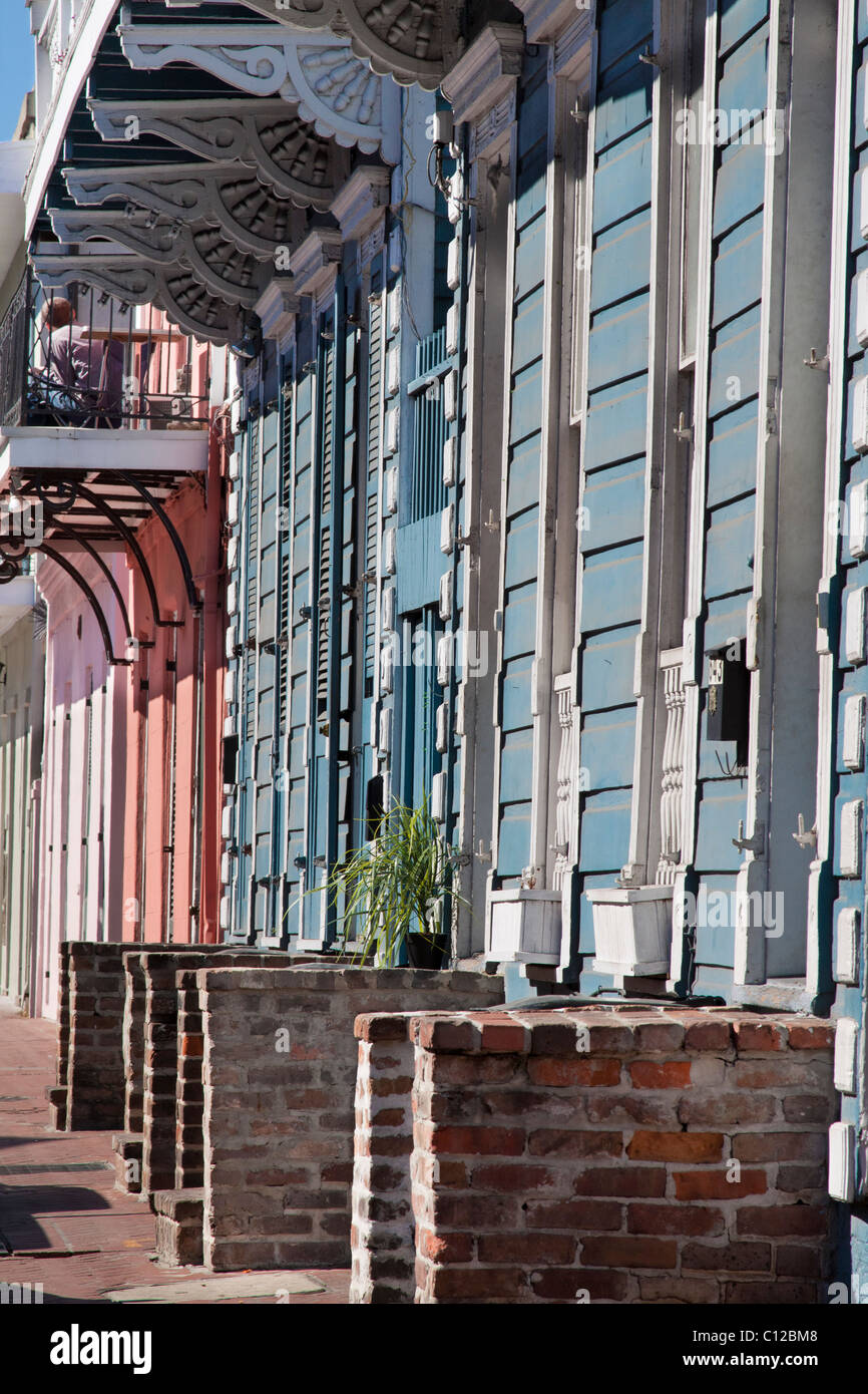 Row of Creole townhouses with brick stoops in the French Quarter of New Orleans, Louisiana - Stock Image
